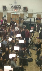 COMPOSER AND DIRECTOR WITH ORCHESTRA.