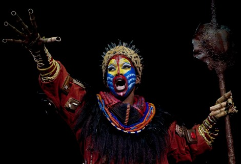 """Actress Brenda Mhlongo dressed as """"Rafiki"""" performs during the press rehearsal of """"El Rey Leon"""" (""""The Lion King"""") musical shows in Madrid October 13, 2011. The musical will be on stage from next October 20, 2011. REUTERS/Sergio Perez (SPAIN - Tags: ENTERTAINMENT) - RTR2SMAB"""