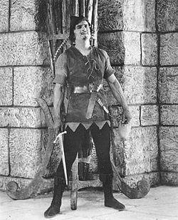 250px-Fairbanks_Robin_Hood_standing_by_wall_w_sword